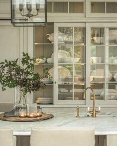 Sliding glass cabinet doors can bring a sense of nostalgia to a kitchen design. Glass Kitchen Cabinets, Glass Cabinet Doors, Kitchen Doors, Sliding Glass Door, Glass Countertops, Green Cabinets, Cupboard Doors, White Cabinets, Home Design