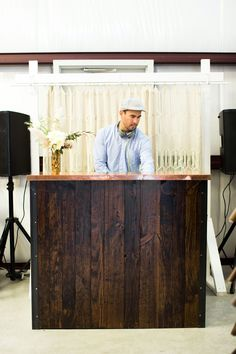 Party DJ Booth Using a Rustic Wood Bar with a Modern Copper Top in Front of a Macrame Backdrop via Birch & Brass Vintage Rentals for Weddings and Special Events in Austin, Texas