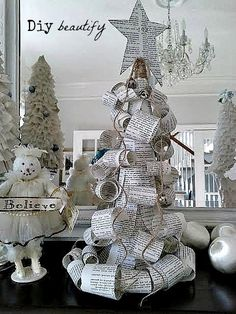 Paper Curl Christmas Trees | DIY beautify Make a really unique tree this Christmas...out of paper! Book paper, dictionary sheets, music sheets, what about using an old thrift store Bible and using the pages from Luke 2 about the birth of Jesus? A big star on top and a couple of jingle bells hung from jute finish it off perfectly! Tutorial available at DIY beautify