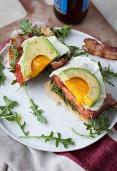 Ultimate BLT Sandwich: Sourdough, bacon, tomato, baby agurula, sunny-side up egg, avocado, and sriracha mayo