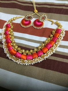 Orange and pink colour silk thread neck set maid with silk thread and decorated with pearls
