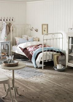 love the iron bed and the light wood paneling and the hooks... its just good. would change the fabrics but like everything else.