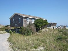 'L'il Seabreeze' is a 3 bedroom vacation rental home located in Nags Head, Nc. Wonderful ocean views there is a screened porch and a sun deck.   Managed by Village Realty.  Property I.D. is SN48