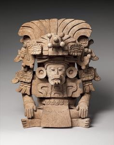 Funerary urn with deity, Monte Alban, Oaxaca, Mexico. Zapotec. 6th century ACE  Ceramic urns were often deposited as funerary offerings at the site of Monte Alban in the southern Mexican state of Oaxaca.