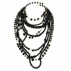 """Showcasing a black bead design, this layered necklace accents your evening ensemble with elegant appeal.   Product: NecklaceConstruction Material: ResinColor: BlackFeatures:  Lobster claw closure11"""" DropDimensions: 15-19"""" Chain length"""