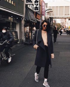 """justthedesign: """" Another simple winter style is demonstrated by Petra here, who has stripped her look back to basics, in a beige sweater, black jeans, and a dark overcoat to contrast white socks and sneakers. We love the contrasting colours of this..."""