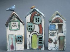 I love these little ceramic houses by artist Dianne Hawkey.  Little birds on the roof!