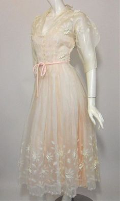 Amazing 1950s Ceil Chapman dress with white silk organza over pale pink tafetta with embroidered floral appliques.