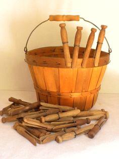 vintage peg basket with 35 vintage wooden clothes pins. $22.00, via Etsy.
