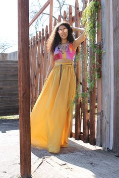 """Find yourself in the middle of it all in the Hawn Yellow Maxi Skirt.  The softly gathered waist is accented with belt loops and a denim belt with ornate silver toggles.  This maxi skirt is fully lined and with features like hidden side pockets you just can't go wrong. #yellow #maxiskirts #skirts #retro  Length  Standard:  44.5"""" / 113.03 cm Tall:  49.5"""" / 125.73 cm"""