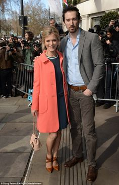 What a treat: Silent Witness star Emilia Foxopted for a chic coral coat and navy dress as...