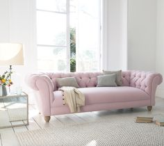 Loaf's comfy Young Bean chesterfield sofa in a pastel pink Pale Rose vintage linen with a deep-buttoned back