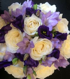 Hand tied wedding bouquet in purple lilac and Ivory