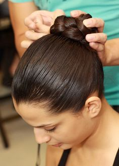 Well oiled hair and braided bun. Looking wonderful