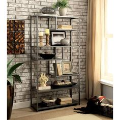"""Easily show off your favorite memorabilia and decorations atop this Kersty Industrial 69"""" Etagere Bookcase! A sturdy metal frame helps keep the asymmetrical piece upright and adds to the metal and wood look. The multiple shelves create a unique pattern as they descent, accentuating the seven-tiered design. With its powder-coated dark gray finish, this piece provides a subtle yet appealing statement for your home décor!"""