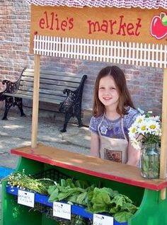 Young lady with her own farmers market booth. I would love for my kids to do this.