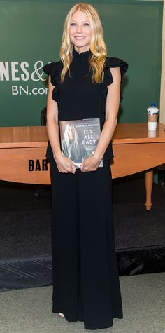 Gwyneth Paltrow was the definition of modern sophistication at the Barnes & Noble signing of her new book It's All Easy in a ruffled high-neck black top and wide-leg pants.