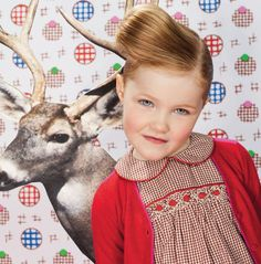 Oilily..not sure I get the deer, or the high fashion hair and pose, but adorable dress on an adorable little girl!