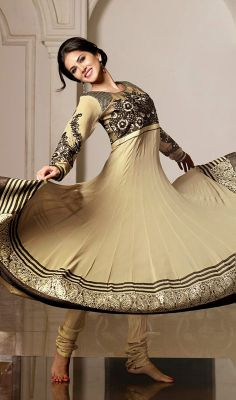 Beige Sunny Leone Flared Georgette Anarkali Churidar Dress Appear stunningly like Sunny Leone in this beige flared georgette Anarkali churidar dress. You will see some interesting patterns completed with butta and resham work.  #GeorgetteAnarkaliChuridarDress #IndianDesignerChuridarSuits
