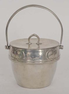 Archibald Knox - Liberty & Co - A Tudric polished pewter cylindrical biscuit box and cover