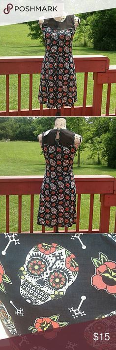 💥SALE💥NWT Hot Topic sugar skull dress Cute black dress with sugar skulls pattern. Very flattering 95% polyesyer, 5% spandex Hot Topic Dresses