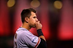 Joe Panik of the San Francisco Giants blows into his hand to stay warm before Game 7 of the 2014 World Series against the Kansas City Royals on Wednesday, October 29, 2014 at Kauffman Stadium in Kansas City, Missouri. (Photo by Brad Mangin/MLB Photos)