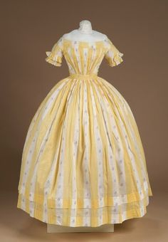 Yellow cotton stripe dress, ca. 1850   front of dress gathered at angles from a wide CORDED WAIST BAND; plain back fastened with hooks and eyes; full skirt (bell shaped) gathered at waist and has two hems