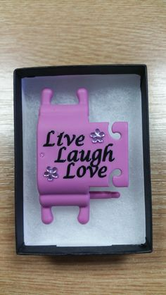 'Live, Love, Laugh' wording to personalise your Phone Buddy. Why not create your own: http://www.phone-buddy.co.uk/pages/phone-buddy-art