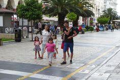 Family walking the pedestrian walkway in Thessaloniki, Greece.