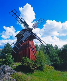 Windmill....the are various types in use nowadays from horizontal to vertical from water pumping to electricity....the idea of a windmill goes back to the Greek engineer Heron of Alexandria in the 1st century AD is the earliest known instance of using a wind-driven wheel to power a machine.