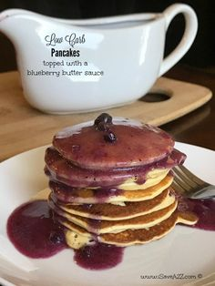 Low Carb Keto Friendly Pancakes topped with a blueberry butter sauce
