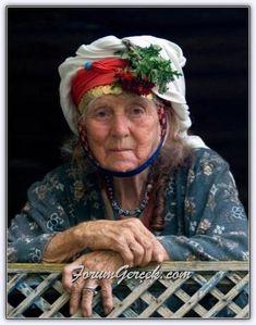 Turkish elderly lady with a red flower in her hijab, head scarf ( Çomakdağ - Milas - Muğla)