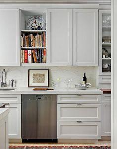 Contemporary Kitchen - nice white, simple backsplash; glass front at right, cookbook shelf, etc
