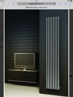 Cool vertical radiator to replace the one on the Left Hand wall where we want to put fitted cupboards