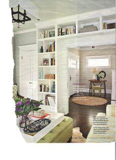 bookshelf around door arch