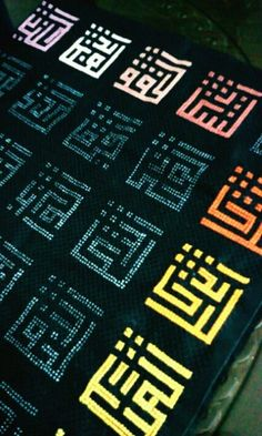 Cross stitches with kufi art