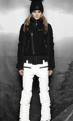 Women's ski wear | Winter fashion | Black ski jacket | White ski pants