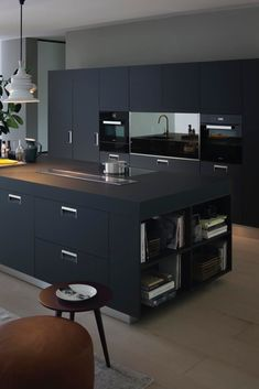 There is no question that designing a new kitchen layout for a large kitchen is much easier than for a small kitchen. A large kitchen provides a designer with adequate space to incorporate many convenient kitchen accessories such as wall ovens, raised. Black Kitchen Cabinets, Black Kitchens, Luxury Kitchens, Cool Kitchens, Kitchen Island, Pantry Cabinets, Kitchen Grey, Kitchen Worktop, Grey Cabinets