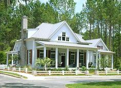 Southern Living Cottage of the year.... Metal roof and covered porches.