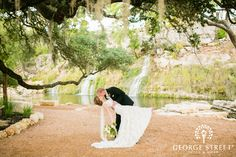 These guys really nailed the dip pose. Check out the rest of Natalie & Pat's beautiful floral-infused wedding!