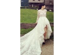 Here is a long sleeve high-low wedding gown that has more of a modest buodice. The illusion neck line and sheer sleeves cover much of the top. The hi-low skirt flows into a train. We can make custom #weddingdresses like this with any changes. We can also make #replicas of any couture dress for you if your dream gown is more than you can afford. Our version will look the same but cost less. Contact us for pricing and more details DariusCordel.com