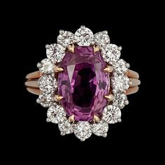 ring with pink saphire and diamonds
