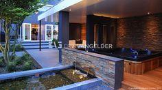 Teo van Horssen | Tuinontwerp exclusieve vijver waterval natuursteen steenstrips Stijltuinen