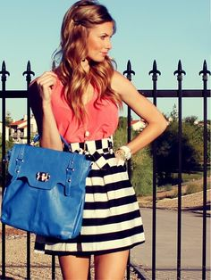 cute striped skirt plus corral top with a blue purse to top it off.!
