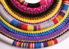 Crocheted, knitted or braided. A cross between a collar and a necklace. Pretty cool!