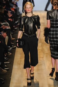 Micheal Kors Fall 2012.  Want that leather blouse...