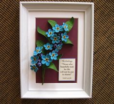 Quilled blue forget-me-not flowers (on a 15x20 cm frame)