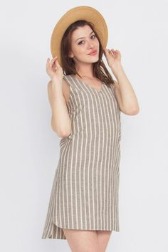 Pin Down Dress Sleeveless stripe shift dress with a V neckline and cutout on back.