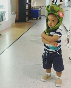 We have some of the cutest visitors. Modeling our triceratops hat.