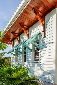 Island-Style Home Boasts Blue Bahama Shutters Photo By Greg Wilson Horizontal siding, colorful Bahama shutters, a beautiful wood soffit and decorative wood brackets create an island-inspired feel at this Florida home. Tropical foliage enhances the design. Beach Cottage Style, Coastal Cottage, Coastal Homes, Beach House Decor, Coastal Style, Coastal Living, Coastal Decor, Southern Living, Beach Cottage Exterior